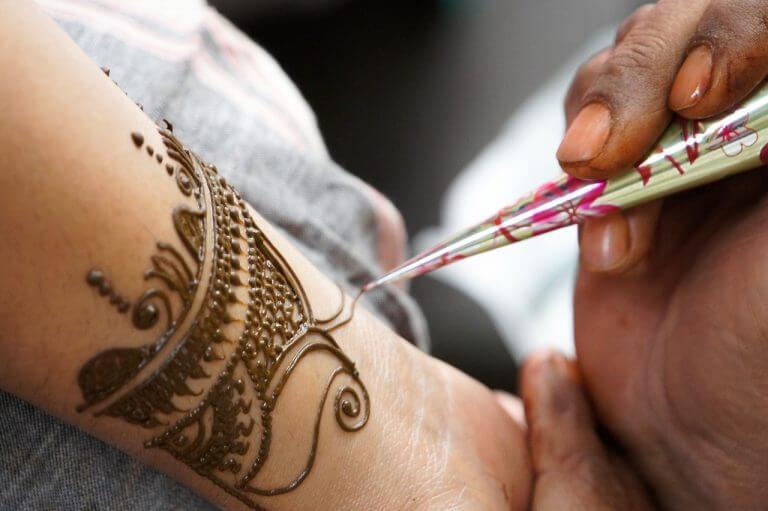 Moroccan women applying henna